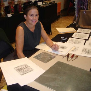I'm signing my at an etching demonstration. You can see the etching plat and tools.